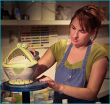 Angela Shope - Painting her pottery.